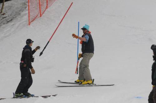 Snowbird coach Carter Gregory giving Bridger Call a hand with his course set.